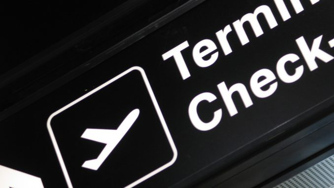 Investing in Ukraine: Airport Terminal Sign Check In